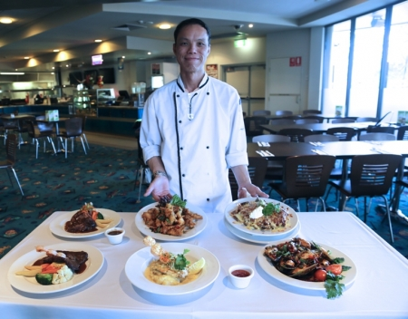 Chef Ben Lo with some of the menu he serves at The Brasserie at West Tradies. Photo by Bernadette Manthey